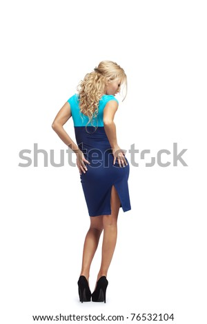 Young blonde woman  in stylish blue dress making some dance moves - stock photo