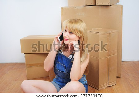young blonde woman moving into new apartment
