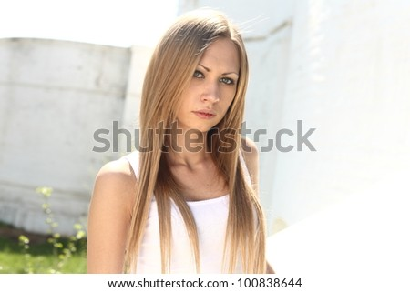 Young blonde woman - outdoors summer portrait - stock photo