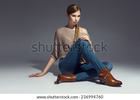 young blonde woman posing in fashionable clothes and shoes - stock photo