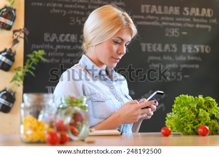 Young blonde woman send messages. - stock photo