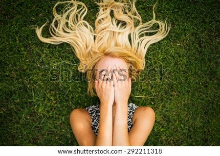 Young blonde woman summer day relaxing. - stock photo