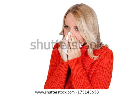 Young blonde woman using a  tissue, isolated on white  - stock photo