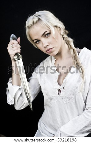 Young blonde woman with a big knife - stock photo