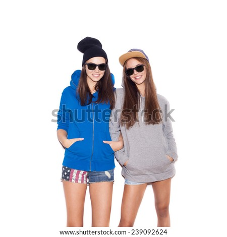 Young blonde women in sunglasses smiling. Two Fashion hipster girls.  White background, not isolated - stock photo