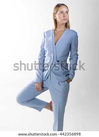 young blonde women wearing blue jacket and pant - stock photo