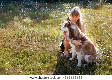 Young blondy woman with her huskey dog