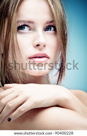 young blue eyes woman beauty portrait, studio shot - stock photo