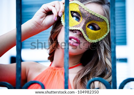 young blue eyes woman  behind mask outdoor shot - stock photo