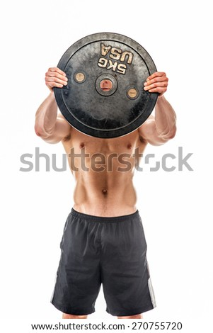 Young bodybuilder holding weights. Isolated on white - stock photo