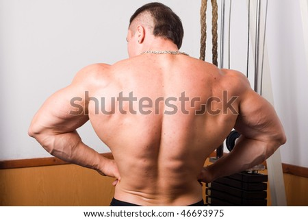 young bodybuilder posing in gym