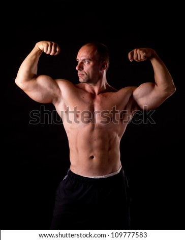young bodybuilder posing in studio