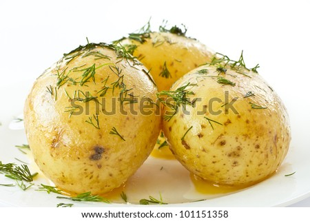 young boiled potatoes with dill in oil - stock photo