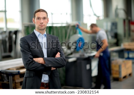 young boss in his factory - stock photo