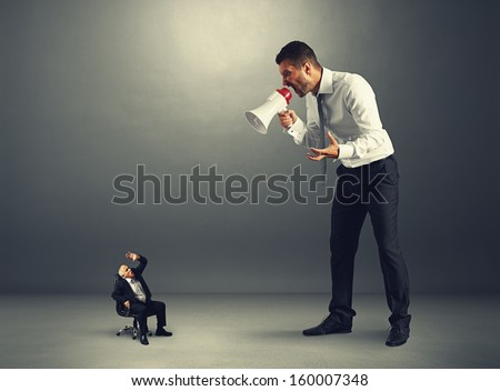 young boss screaming at senior worker