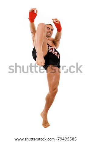 Young Boxer fighter making a kick over white background - stock photo