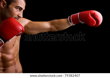 Young Boxer fighter over over black background - stock photo