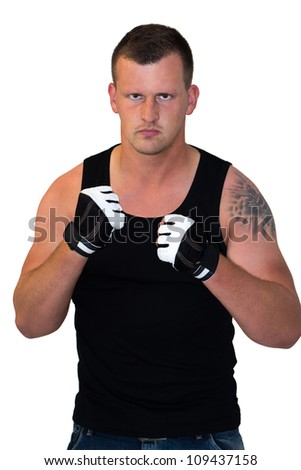 Young Boxer looking into Camera and ready for a fight
