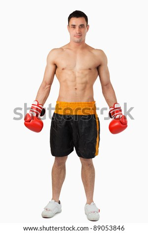 Young boxer ready to fight against a white background - stock photo