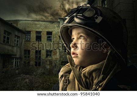 Young boy alone  in a war zone - stock photo