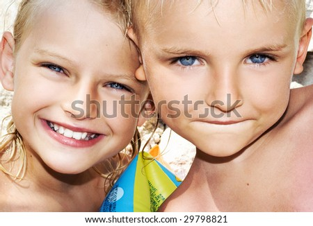 Young boy and child on sunny vacation day - stock photo