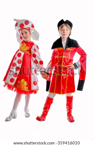 young boy and girl in medieval carnival costume, red caftan, cocked hat, tricornred and white fluffy skirt - stock photo