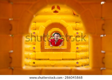 Young boy, asian kid or child playing outdoors on playground. - stock photo