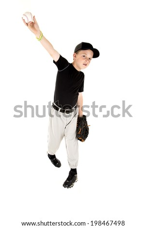 young boy baseball player in uniform pitching a baseball - stock photo