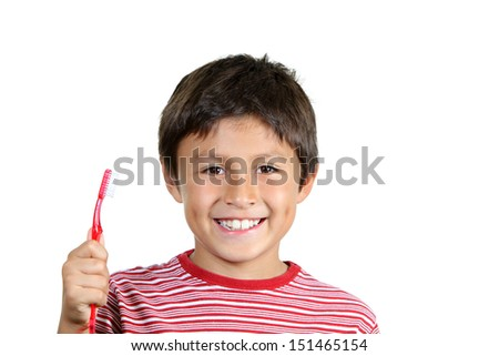 Young boy brushing his teeth on white background - stock photo