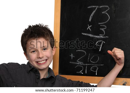 young boy cheering over his math success - stock photo