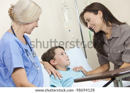 Young boy child in a hospital bed with his mother visiting and a senior woman female doctor - stock photo