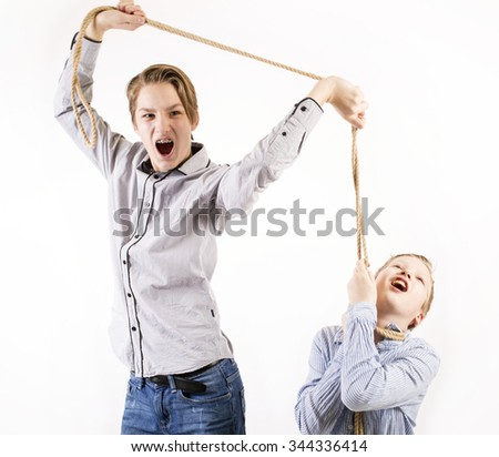 Young boy chocking another boy with a rope isolated on white background. - stock photo