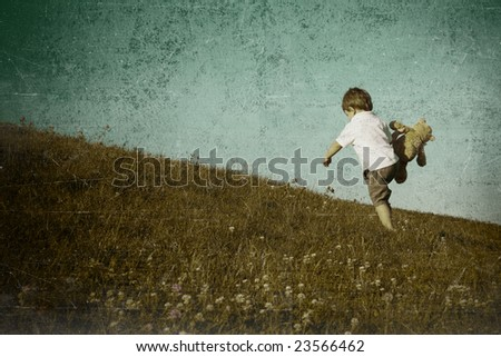 young boy climbing hill - stock photo
