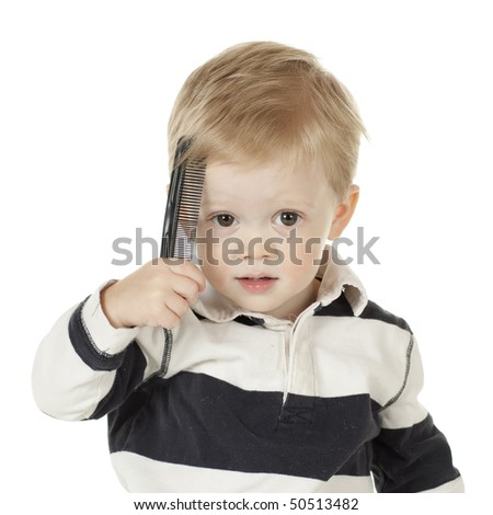 Young Boy Combing His Hair - stock photo
