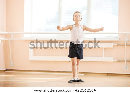 Young boy dancing at a ballet class - stock photo