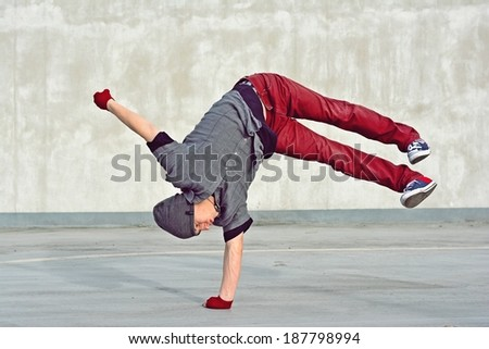 Young boy dancing break dance on the street - stock photo
