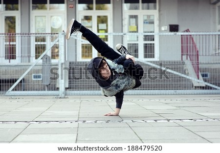 Young boy dancing breakdance on the street - stock photo