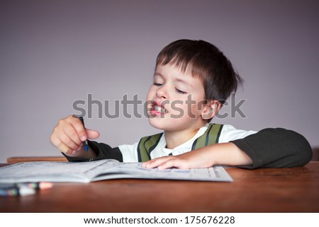 Young boy doing his homework at home