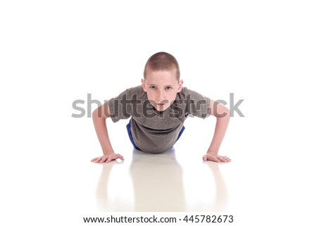 Young boy doing push ups