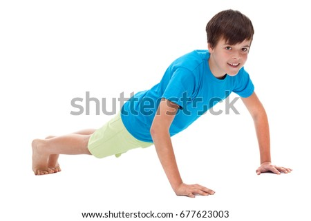 Young boy doing push ups - isolated