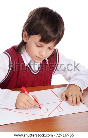 young boy drawing house isolated on white