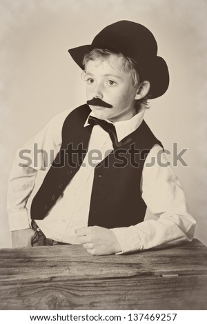 Young boy dressed as a western bartender; vintage