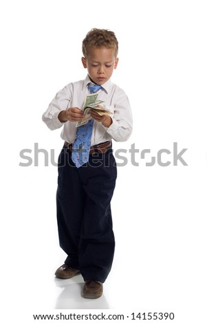 Young boy dressed as businessman holds money - isolated on white