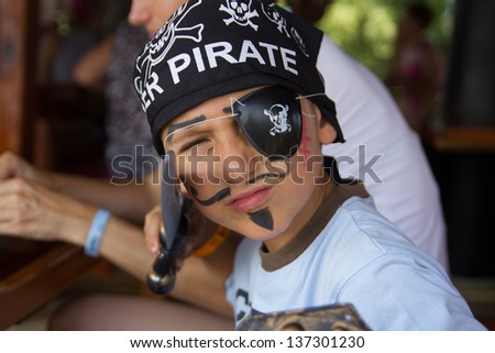 Young boy dressed as pirates - stock photo