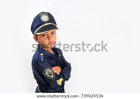 Young boy dressed up in a police uniform for Halloween