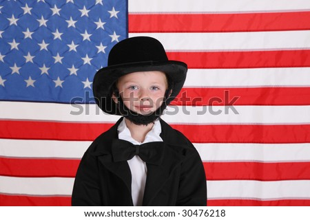 Young boy dressed up like Abraham Lincoln