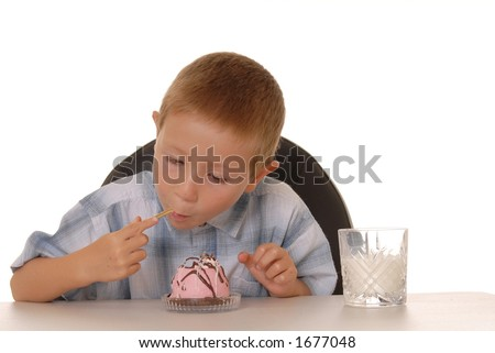 Young boy eating dessert
