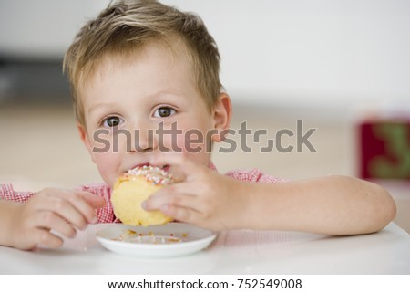 young boy eating sweet dumpling