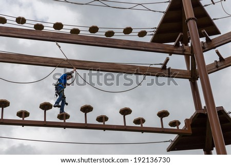 Young boy engaging an obstacle course - stock photo