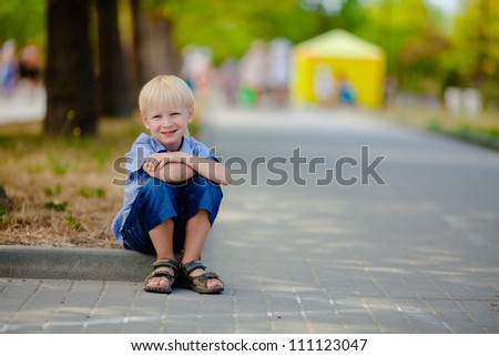 Young boy enjoying in outdoor park